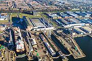 Nederland, Noord-Holland, Amsterdam, 11-12-2013; Amsterdam-Noord, t.t. Vasumweg. Droogdokken voor scheepsreparatie op de scheepswerf van Shipdock (Amsterdam Ship Repair). Terrein oorspronkelijk van voorheen ADM (Amsterdamse Droogdok Maatschappij) of NDM (Nederlandse Dok Maatschappij)<br /> Dry docks for ship repair at the shipyard Shipdock.<br /> luchtfoto (toeslag op standaard tarieven);<br /> aerial photo (additional fee required);<br /> copyright foto/photo Siebe Swart.