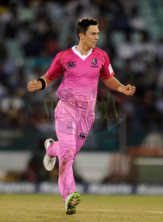 Trent Boult of Northern Knights celebrates the wicket of Ambati Rayudu of Mumbai Indians during the qualifier 5 match of the Oppo Champions League Twenty20 between the Southern Express and the Lahore Lions held at the Chhattisgarh International Cricket Stadium, Raipur, India on the 16th September 2014<br /> <br /> Photo by:  Pal Pillai / Sportzpics/ CLT20<br /> <br /> <br /> Image use is subject to the terms and conditions as laid out by the BCCI/ CLT20.  The terms and conditions can be downloaded here:<br /> <br /> http://sportzpics.photoshelter.com/gallery/CLT20-Image-Terms-and-Conditions-2014/G0000IfNJn535VPU/C0000QhhKadWcjYs