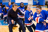 New York Rangers head coach John Tortorella helps his little teammates in a tug-of-war at the Garden of Dreams Foundation's Coaches Challenge.