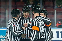 KELOWNA, CANADA - DECEMBER 5:  The  ice officials take part in a pre-game ritual at the Kelowna Rockets against the Tri-City Americans on December 5, 2018 at Prospera Place in Kelowna, British Columbia, Canada.  (Photo by Marissa Baecker/Shoot the Breeze)