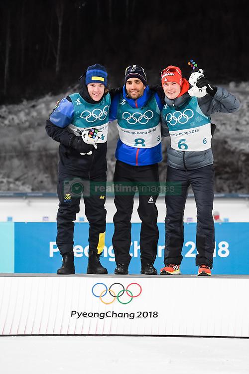 February 12, 2018 - Pyeongchang, SOUTH KOREA - 180212  Sebastian Samuelsson of Sweden, Silver, Martin Fourcae of France, Gold,  and Benedikt Doll of Germany, Bronze, celebrates on the podium after in the Men's Biathlon 12,5km Pursuit during day three of the 2018 Winter Olympics on February 12, 2018 in Pyeongchang..Photo: Jon Olav Nesvold / BILDBYRÃ…N / kod JE / 160157 (Credit Image: © Jon Olav Nesvold/Bildbyran via ZUMA Press)