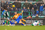 Joe Worrall (#3) of Rangers FC blocks a shot from Marc McNulty (#9) of Hibernian FC during the Ladbrokes Scottish Premiership match between Hibernian and Rangers at Easter Road, Edinburgh, Scotland on 8 March 2019.
