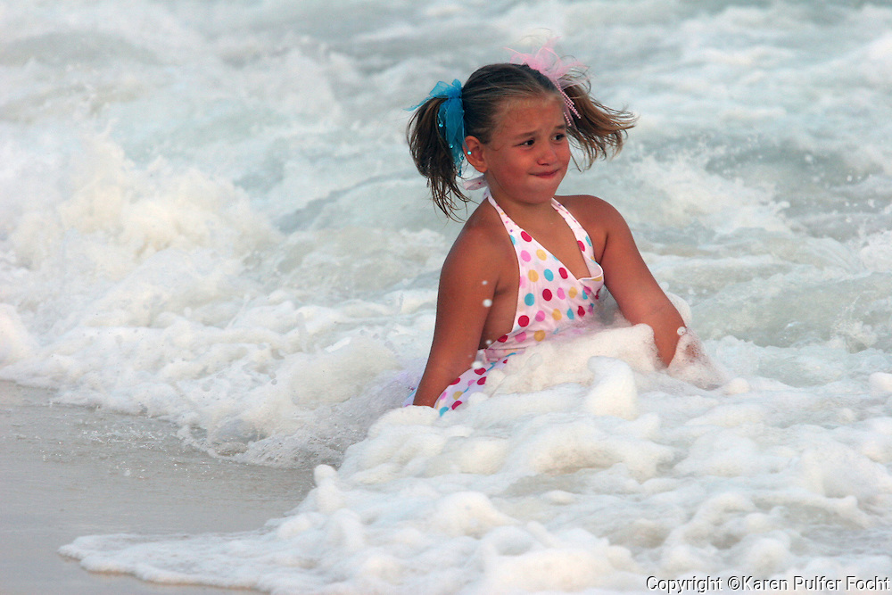 Girl playing in waves.