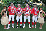 KO OLINA - FEBRUARY 10:  New England Patriots 2005 NFL Pro Bowl AFC All-Stars (left to right: Tom Brady #12, Larry Izzo #53, Tedy Bruschi #54, and Adam Vinatieri #4) pose with Hawaiian Hula girls for their 2005 NFL Pro Bowl team photo on February 10, 2005 in Ko Olina, Hawaii. ©Paul Anthony Spinelli