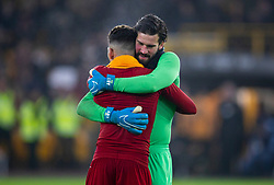 WOLVERHAMPTON, ENGLAND - Thursday, January 23, 2020: Liverpool's match-winning goal-scorer Roberto Firmino (L) celebrates with goalkeeper Alisson Becker after the FA Premier League match between Wolverhampton Wanderers FC and Liverpool FC at Molineux Stadium. Liverpool won 2-1. (Pic by David Rawcliffe/Propaganda)