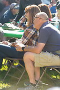 Cute couple enjoys listening to music during the Thousand Springs Art Festival at Ritter Island near Hagerman, Idaho. MR