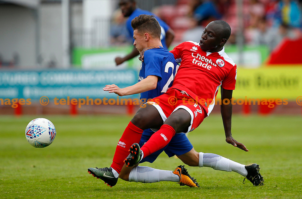 Kaby Djalo of Crawley tackles during the pre season friendly between Crawley Town and Chelsea XI at the Checkatrade Stadium in Crawley. 15 Jul 2017