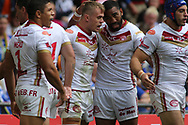 Lewis Tierney (c) of Catalans Dragons  celebrates scoring the 1st try of the game with his team mates against Warrington Wolves during the Ladbrokes Challenge Cup Final match at Wembley Stadium, London<br /> Picture by Stephen Gaunt/Focus Images Ltd +447904 833202<br /> 25/08/2018