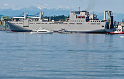USNS BRITTIN   (T-AKR 305).Large, Medium-Speed Roll-on/Roll-off Ship arriving at Puget Sound Naval Shipyard in Bremerton, Washington Also seen in the foreground is the fast ferry Rich Passage I and a US Navy Tug.... on the far left is the Hammerhead Crane.