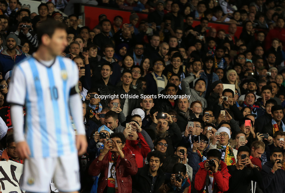 18 November 2014 - International Friendly - Argentina v Portugal - Fans rise in unison to take photos of Lionel Messi of Argentina - Photo: Marc Atkins / Offside.