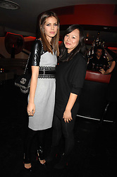 Left to right, DASHA ZHUKOVA and CHRISTINA TANG Kova & T designers at a party to celebrate the launch of the Kova & T fashion label and to re-launch the Harvey Nichols Fifth Floor Bar, held at harvey Nichols, Knightsbridge, London on 22nd November 2007.<br /><br />NON EXCLUSIVE - WORLD RIGHTS