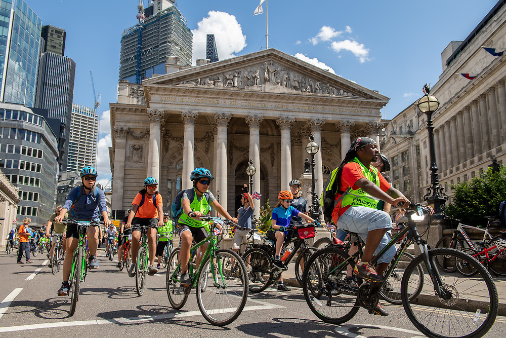 Cyclists come through the Bank Junction past the Bank of England and The Royal Exchange. Prudential RideLondon FreeCycle. Saturday 28th July 2018<br /> <br /> Photo: Thomas Lovelock for Prudential RideLondon<br /> <br /> Prudential RideLondon is the world's greatest festival of cycling, involving 100,000+ cyclists - from Olympic champions to a free family fun ride - riding in events over closed roads in London and Surrey over the weekend of 28th and 29th July 2018<br /> <br /> See www.PrudentialRideLondon.co.uk for more.<br /> <br /> For further information: media@londonmarathonevents.co.uk