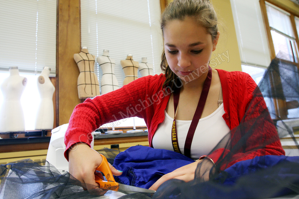 A high school student cuts tool off her garment during Fashion Camp photo by Emily Mesner