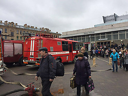 April 3, 2017 - Saint Petersburg, Russia - Rescue vehicles outside as commuters walk away from the station after the explosion. A suspected bomb detonated on a metro train in St Petersburg on Monday, killing at least 10 people. The blast occurred at the Sennaya Ploshchad station, in the centre of Russia's second city, at about 2.30pm, reportedly as the train was pulling out of the station.. (Credit Image: © Russian Look via ZUMA Wire)
