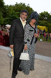 JAMES CAAN and his wife AISHA CAAN at The Animal Ball in aid of The Elephant Family held at Lancaster House, London on 9th July 2013.