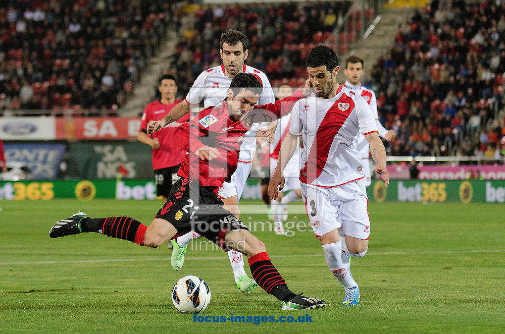 Picture by Cristian Trujillo/Focus Images Ltd +34 64958 5571.19/04/2013.Alejandro Alfaro of Real Club Deportivo Mallorca (left) and José Manuel Casado of Rayo Vallecano (right) during the La Liga match at Iberostar Stadium, Palma.