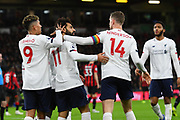 Goal - Mohamed Salah (11) of Liverpool celebrates after he scores a goal to give a 0-3 lead with Roberto Firmino (9) of Liverpool and Jordan Henderson (14) of Liverpool  during the Premier League match between Bournemouth and Liverpool at the Vitality Stadium, Bournemouth, England on 7 December 2019.