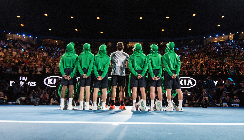 Roger Federer of Switzerland and ball kids after the men's final on day fourteen of the 2017 Australian Open at Melbourne Park on January 29, 2017 in Melbourne, Australia.<br /> (Ben Solomon/Tennis Australia)