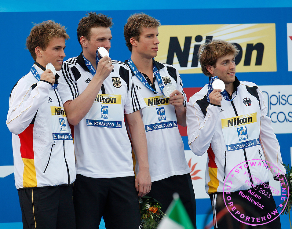 ROME 02/08/2009.13th Fina World Championships.Germany relay team members pose on the podium with their silver medals after the men's 4 X 100m medley relay swimming final at the World Championships.photo: Piotr Hawalej / WROFOTO