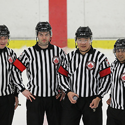 Georgetown, ON  - MAR 31,  2018: Ontario Junior Hockey League, South West Conference Championship Series. Game two of the best of seven series between the  Toronto Patriots and the Georgetown Raiders. The Officiating Crew for game two of the series Linesman  Kyle Pessoa, Referee Tyson Orlie and Ryan Park. Linesman Zalman Estrange.<br /> (Photo by Tim Bates / OJHL Images)