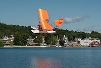 Keith and Pamela Markley take off in their Quicksilver Seaplane over Center Harbor Bay on Lake Winnipesaukee Friday morning.  (Karen Bobotas/for the Laconia Daily Sun)