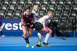 Wimbledon's Libby Sherriff goes past Zoe Shipperley of Buckingham. Wimbledon v Buckingham - Investec Women's Hockey League Finals, Lee Valley Hockey & Tennis Centre, London, UK on 23 April 2017. Photo: Simon Parker