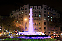 The bright lights of Barcelona's central square - the Placa de Catalunya - lit up at night.