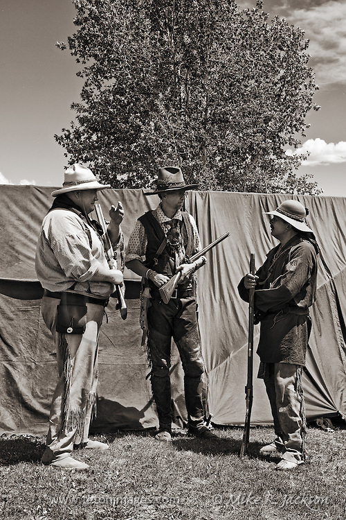 Three Trappers in conversation at the Mountain Man Rendezvous at Pinedale, WY.