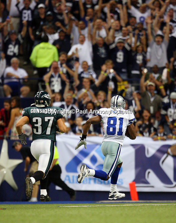 IRVING, TX - SEPTEMBER 15:  Wide receiver Terrell Owens #81 of the Dallas Cowboys races for the end zone on a 72 yard touchdown pass for a 7-3 Cowboys first quarter lead while covered by safety Sean Considine #37 of the Philadelphia Eagles at Texas Stadium on September 15, 2008 in Irving, Texas. The Cowboys defeated the Eagles 41-37. ©Paul Anthony Spinelli *** Local Caption *** Terrell Owens;Sean Considine