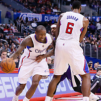23 November 2013: Los Angeles Clippers shooting guard Jamal Crawford (11) drives past Sacramento Kings point guard Isaiah Thomas (22) on a screen set by Los Angeles Clippers center DeAndre Jordan (6) during the Los Angeles Clippers 103-102 victory over the Sacramento Kings at the Staples Center, Los Angeles, California, USA.