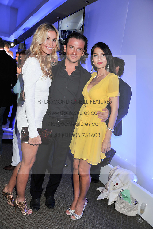 Left to right, Melissa Odabash, Manuele Malenotti and Yasmin Mills at a VIP dinner hosted by Maserati following the unveiling of the new Maserati 'Quattroporte' at The Hurlingham Club, London on 17th April 2013.