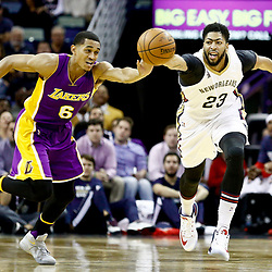 Nov 29, 2016; New Orleans, LA, USA; New Orleans Pelicans forward Anthony Davis (23) and Los Angeles Lakers guard Jordan Clarkson (6) chase a loose ball during the first quarter of a game at the Smoothie King Center. Mandatory Credit: Derick E. Hingle-USA TODAY Sports