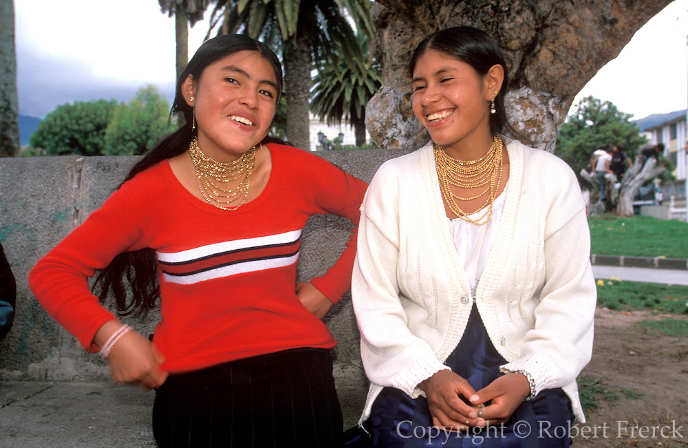 ECUADOR, HIGHLANDS NORTH OF QUITO teenage students on the main plaza of  Otavalo, a town famous for its colorful craft and produce market