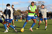 AFC Wimbledon defender Toby Sibbick (20), AFC Wimbledon midfielder Liam Trotter (14) and AFC Wimbledon midfielder Anthony Hartigan (8) warming up during the EFL Sky Bet League 1 match between AFC Wimbledon and Shrewsbury Town at the Cherry Red Records Stadium, Kingston, England on 3 November 2018.