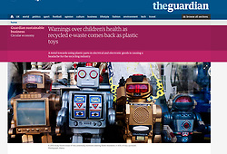 The Guardian; toy robots in shop window