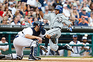 May 24, 2014; Detroit, MI, USA; Texas Rangers third baseman Adrian Beltre (29) slides in safe at home ahead of the throw to Detroit Tigers catcher Alex Avila (13) in the fourth inning at Comerica Park. Mandatory Credit: Rick Osentoski-USA TODAY Sports