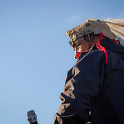 Norman Patrick Brown, Diné, speaks during a protest and march from in front of the U.S. Capitol to the EPA, about the North Dakota Access Pipeline, as well as the effort to free Leonard Peltier.  Saturday, December 10, 2016. John Boal Photography