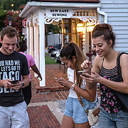 OCCOQUAN, VA - AUG4: People play Pokemon Go along the waterfront in Occoquan, Virginia, August 4th, 2016. This sleepy Virginia town has become a hotspot for Pokemon Go. Throughout the night, kids and young adults play the game on the streets, leaving beer bottles and litter behind. A few residents have complained to city hall and now the city is hiring extra police officers to handle the new masses. (Photo by Evelyn Hockstein/For The Washington Post)