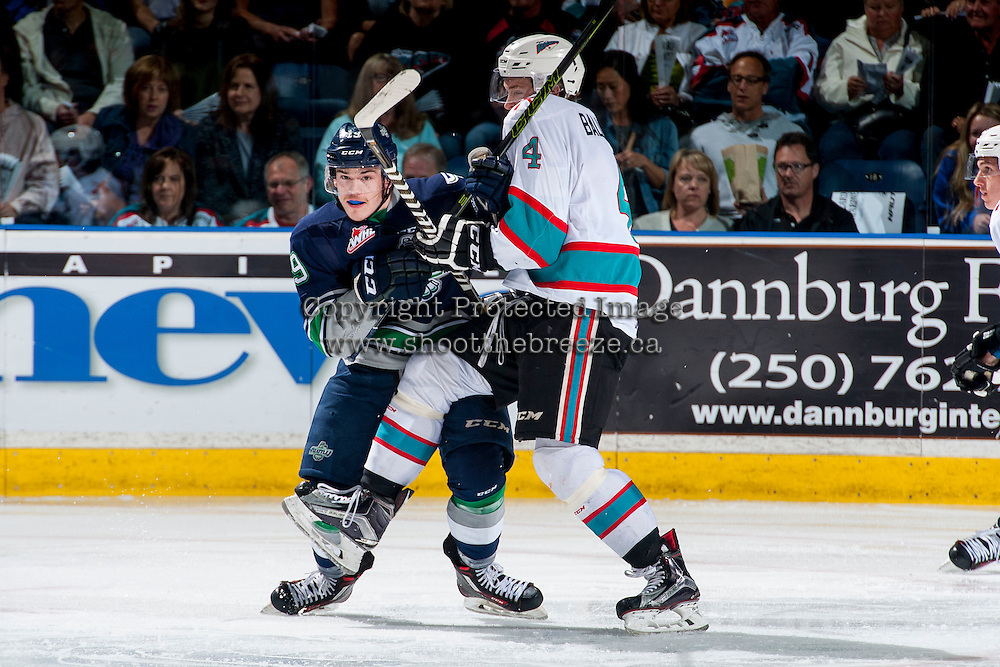 KELOWNA, CANADA - APRIL 22: Gordie Ballhorn #4 of Kelowna Rockets checks Donovan Neuls #19 of Seattle Thunderbirds on April 22, 2016 at Prospera Place in Kelowna, British Columbia, Canada.  (Photo by Marissa Baecker/Shoot the Breeze)  *** Local Caption *** Gordie Ballhorn; Donovan Neuls;