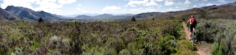 Neil Gardiner makes his way over the pass out of the Brandvlei Valley heading towards Oak Valley on the ABSA Cape Epic Trial Ride for the 2010 event. Picture by Greg Beadle Stitched Panoramic Images taken in and around Cape Town Images by Greg Beadle