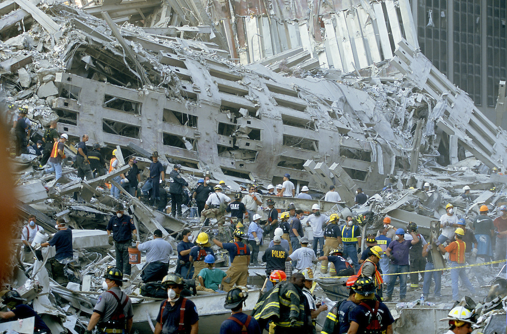Rescue workers pore over the rubble of the World Trade Center searching for survivors after the 9/11/01 terrorist attack on the Twin Towers in NYC. Photo by Lisa Quinones