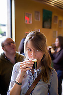 Claire Trageser samples a beer at Ballast Point Brewing Company's headquarters in San Diego.