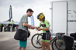 Carmen Small (USA) of Cylance Pro Cycling signs an autograph before the start of the 121.5 km road race of the UCI Women's World Tour's 2016 Grand Prix Plouay women's road cycling race on August 27, 2016 in Plouay, France. (Photo by Balint Hamvas/Velofocus)