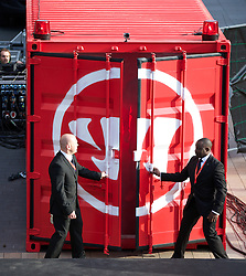 LIVERPOOL, ENGLAND - Thursday, April 10, 2014: Two security men open the doors of a shipping container as Liverpool launch the new Warrior home kit for 2014/2015 at the Liverpool One shopping centre. (Pic by David Rawcliffe/Propaganda)