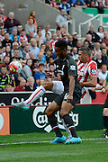 Joe Gomez and Jonathan Walters battle during the Barclays Premier League match between Stoke City and Liverpool at the Britannia Stadium, Stoke-on-Trent, England on 9 August 2015. Photo by Alan Franklin.
