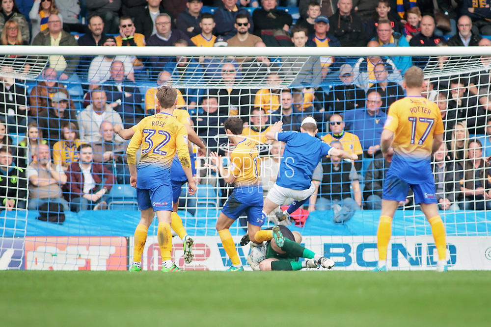 Mansfield Town goalkeeper Conrad Logan (1) collects the ball in front of Chesterfield defender Andy Kellett (24) during the EFL Sky Bet League 2 match between Chesterfield and Mansfield Town at the Proact stadium, Chesterfield, England on 14 A pril 2018. Picture by Nigel Cole.