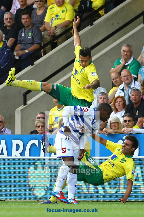 Picture by Paul Chesterton/Focus Images Ltd +44 7904 640267.25/08/2012.Bradley Johnson of Norwich wins a header but clatters team mate Javier Garrido of Norwich during the Barclays Premier League match at Carrow Road, Norwich.