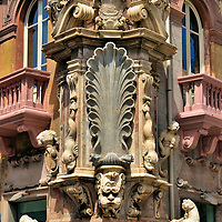One of Four Fountains in Messina, Italy<br /> From 1666 until 1742, the Four Fountains were constructed at the intersection of Via I Settembre and Via Cardines. They were designed by Giacomo Calcagni yet carved from marble by different sculptors. After the 1908 earthquake, only two of La Quattro Fontane were partially restored and reinstalled. This one is decorated with tritons and dolphins. Note the eagle on top. This represents the Spanish insignia. The Spanish period in Sicily began in 1479 and extended through the 18th century.