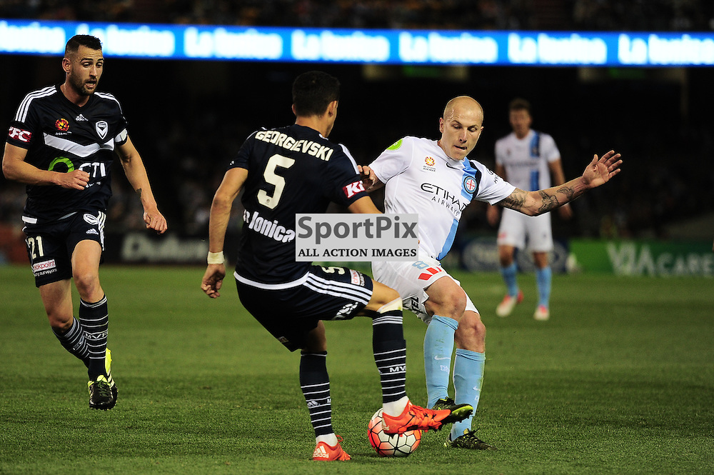 """Daniel Georgievski of Melbourne Victory, Carl Valeri (c) of Melbourne Victory, Aaron Mooy of Melbourne City - Hyundai A-League - October 17th 2015 - ROUND 2- Melbourne Victory FC v Melbourne City FC in the first derby for the 2015 season with a 3:2 win to Victory on the 90"""" - © Mark Avellino 