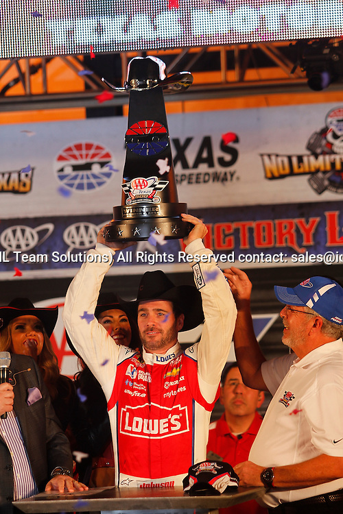 November 02, 2014: Sprint Cup Series driver Jimmie Johnson #48 celebrates in victory lane after winning the AAA Texas 500 at Texas Motor Speedway in Fort Worth, Texas.